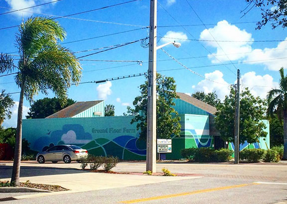 A exterior mural for 'Ground Floor Farm' in Stuart, Florida. Painted by Marga Doek as part of their Mural Project.